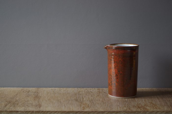 thrown stoneware pourer glazed in persimmon by James and Tilla Waters